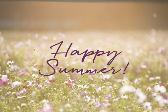 "Text over a field of flower saying ""Happy Summer"""